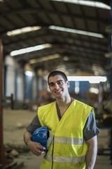 Posing worker in factory, Cordoba, Spain.