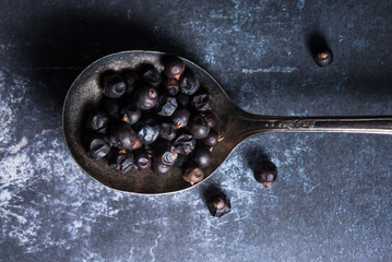 Juniper berries on vintage spoon