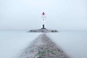Tokarevsky lighthouse at the misty day. Vladivistok, Russia.