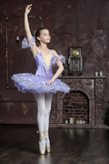 Young ballerina in lilac