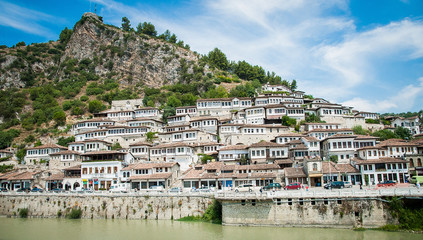2016 Albania Berat - City of thousand windows, beautifull view of town on the hill between a lot of trees and blue sky