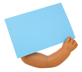 Doll arm and hand holding blank blue note card. Isolated.