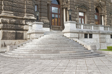 The historic entrance with stairs and ornamental railing