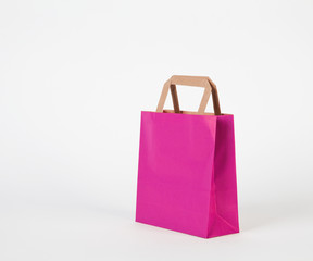 Magenta shopping bag.