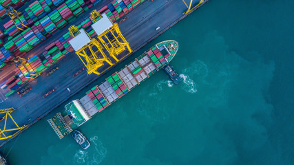 Aerial view from drone, container ship in import export and business logistic by crane