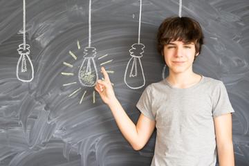 Teen boy getting an idea - back to school education concept