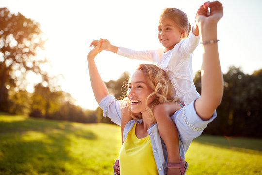 Happy woman with child together outdoor