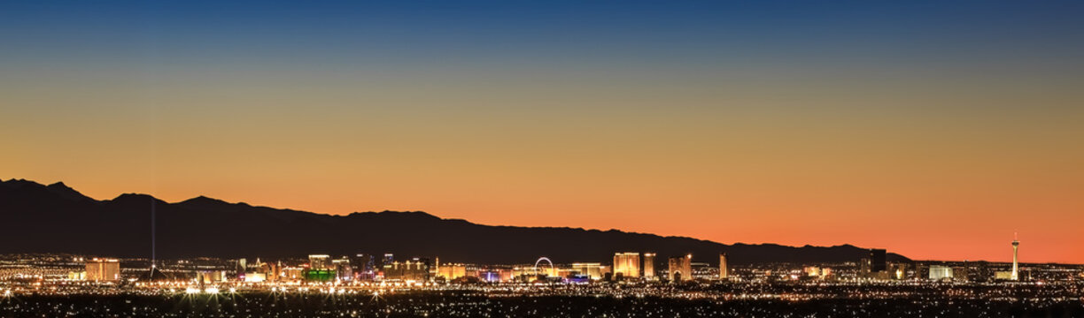 Colorful sunset over Las Vegas, NV cityscape with city lights