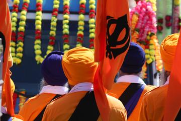 men in orange dress during a sikh event