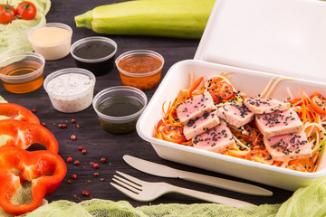 Tuna and carrots, sweet pepper salad and cherry tomatoes, sesame and sauce