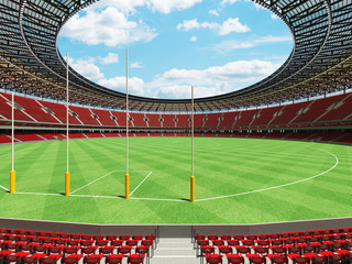 3D render of a round Australian rules football stadium with  red seats and VIP boxes