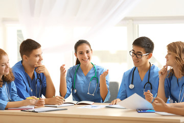 Group of medical students having lecture indoors