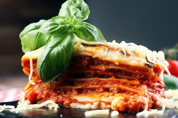 Serving of spicy traditional Italian beef lasagne in a restauran