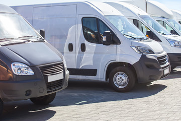 minibuses and vans outside