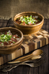 Rice with bacon and green onions. Nourishing lunch for two in clay dishes