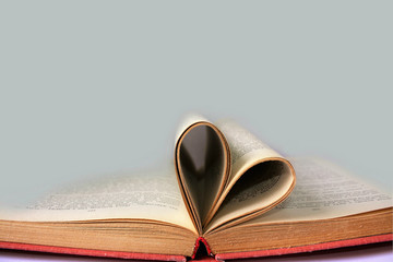 Heart symbol from book pages with empty space for text