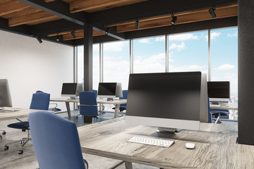 Office with metal pillars, one computer