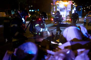 Firefighters work in a fire.