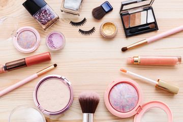 Cosmetic and makeup products on wooden background