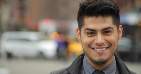 Young Hispanic Latino man in city face portrait