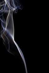 Abstract white blue smoke from aromatic sticks.