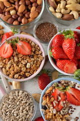 Muesli, nuts, yogurt and cereals on a white background