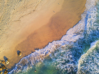 Clear water beach in the morning aerial view.