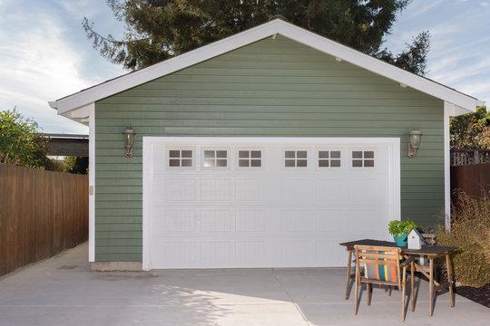 Green house exterior with white garage door