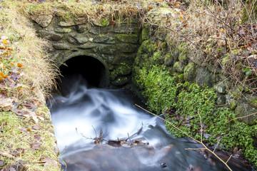 water flowing under bridge