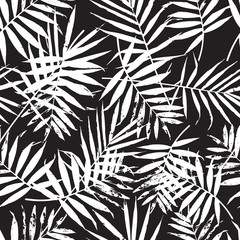 Hand drawn vector leaf seamless pattern. Abstract grunge texture background. Nature organic illustration. Black and white palm leaves pattern. Trendy background with palm texture.