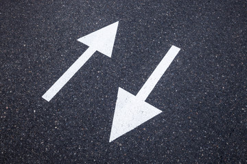 Direction sign on the asphalt road