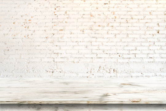 Empty clear white wood table for product placement or montage, Horizontal style. vintage white brick wall background.