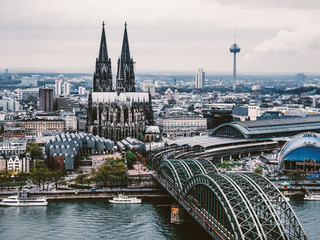 Panoramic cityscape of Cologne city (Cologne Cathedral, Hohenzollern Bridge and Colonius)