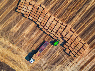 Aerial view of harvest field and hay bales