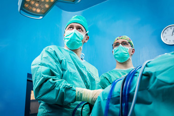 Orthopedic surgeons portrait while performing arthroscopic surgery on human patient.