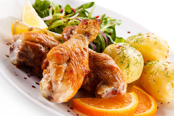 Roast drumsticks with potatoes