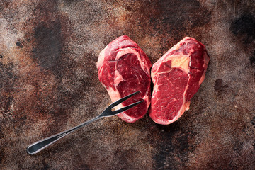 Wall Mural - Raw fresh meat Ribeye Steak heart shape on old rusty texture