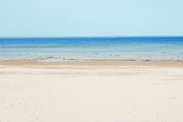Empty sand beach and the sea