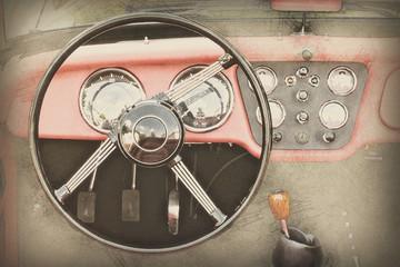 Steering wheel and dashboard in vintage car, illustration
