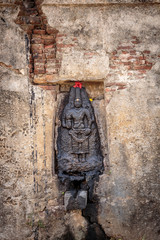 Hindu idol in outer wall of shiva temple
