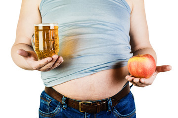 A man with a big belly holding a glass of beer and an Apple. The choice between fruit and beer.