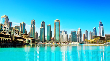 Downtown Dubai skyline, panoramic view from the Dubai fountain. Modern city cityscape with skyscrapers, sunny day.