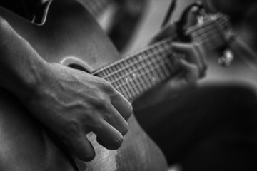 Hands on the guitar
