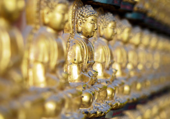 gold buddha statue on wall