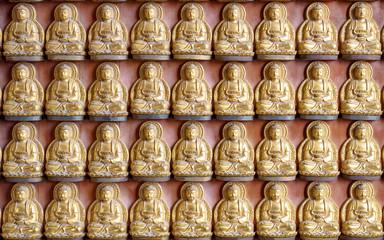 gold buddha statue on wall