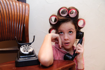 Girl chatting on a retro telephone
