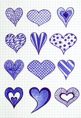 Twelve hand drawn heart shapes on the sheet of checkered paper. Doodle style.