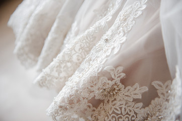 Wedding Dress. A close picture. Embroidery on the dress.
