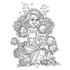 Cute little mermaid girl sits on a stone playing with fish outlined isolated on a white background