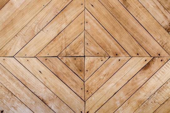 Wooden background texture. Rhombus and triangular wood background.